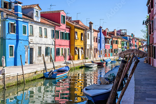 Canvas Prints Daylight view to parked boats in a canal with image reflecting