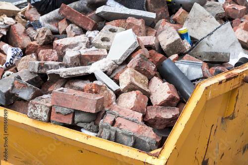 Fotografie, Obraz  Yellow metal skip full of old bricks