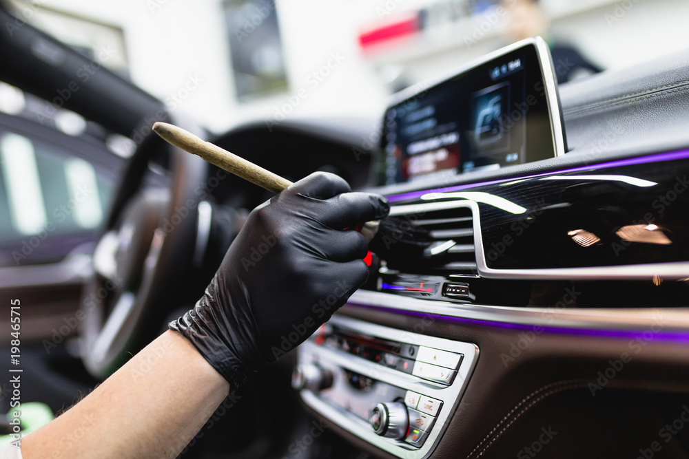 Fototapety, obrazy: A man cleaning car interior, car detailing (or valeting) concept. Selective focus.