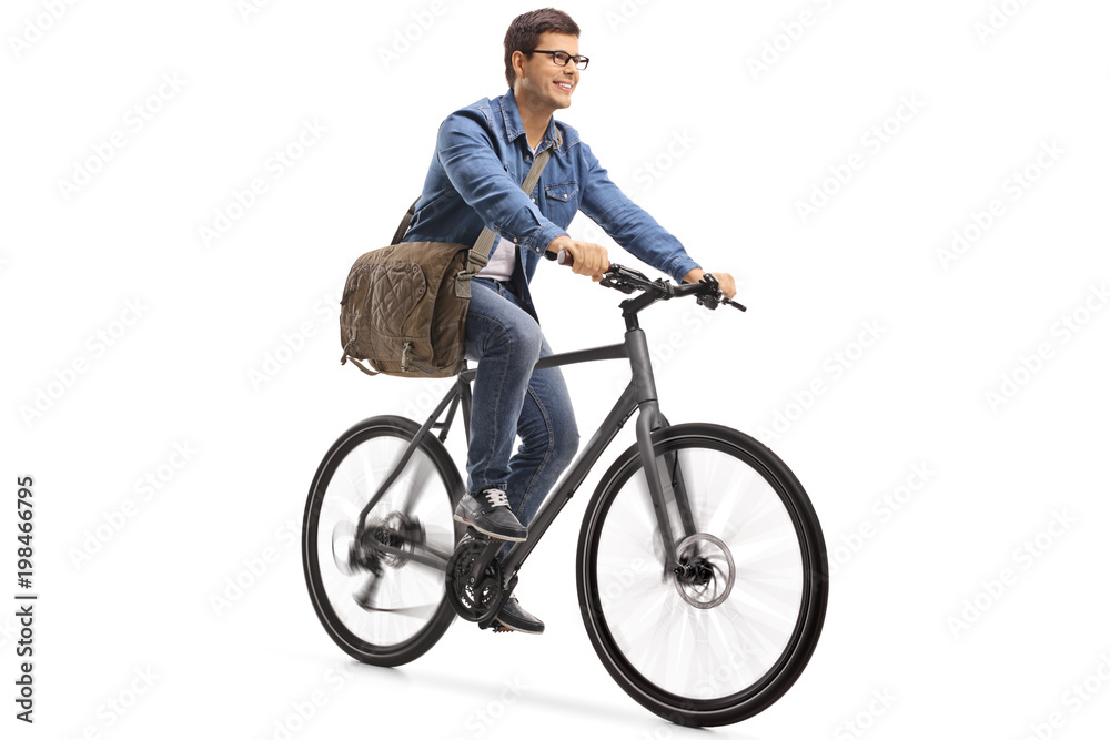 Fototapeta Young guy riding a bicycle