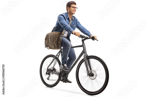 Young guy riding a bicycle