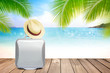 Brown straw hat and suitcase on wooden table with blurred sea,blue sky and palm tree background with copy space.Summer holiday traveling concept.