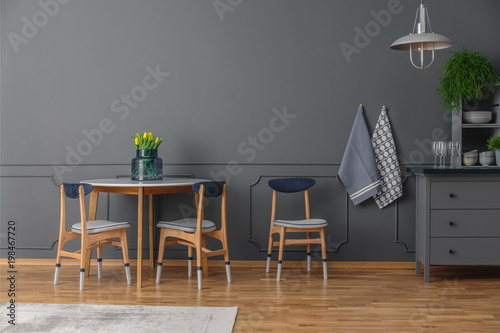 Papiers peints Statue Table in simple kitchen interior