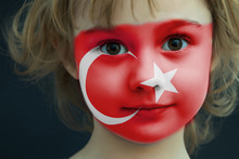 Portrait Of A Child With A Painted Turkish Flag