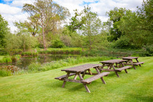 Picnic Tables By A Pond In Southern England UK
