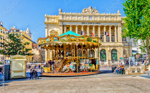Fotografie, Tablou  One of Marseille square with a merry-go-round and the Palais de la Bourse buil