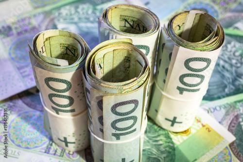 Fotografía  Rolls of hundred zloty banknotes
