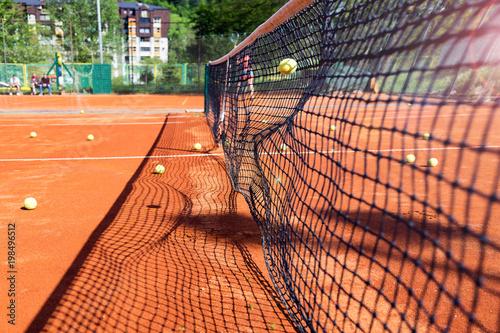 Valokuvatapetti Tennis ball hitting the tennis net at tennis court