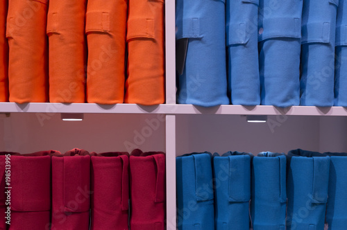 Elegant colorful polo shirts in strange pile on sale Wallpaper Mural