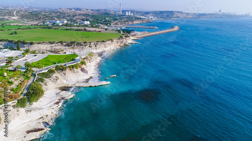 Foto op Canvas Cyprus Aerial view of coastline and landmark big white chalk rock at Governor's beach,Limassol, Cyprus. Steep stone cliffs and deep blue sea waves next to Kalymnos fish restaurant and vasilikos power station