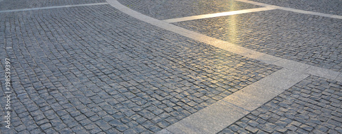 Fotografie, Obraz Fragment of the street square, folded out of a gray square paving stone