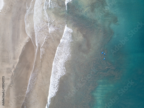 Poster Taupe Coast of the blue ocean and a magnificent beach, view from the air