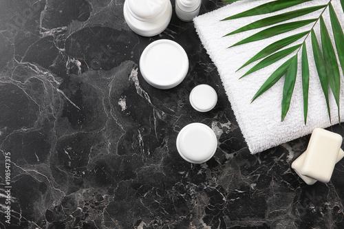 Fototapeta Flat lay composition with body care cosmetics on grey background obraz na płótnie