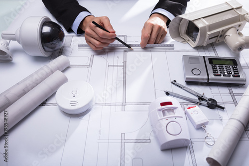 Close-up Of An Architect's Hand Drawing Blueprint