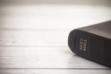 Closed Bible On A Wooden Table