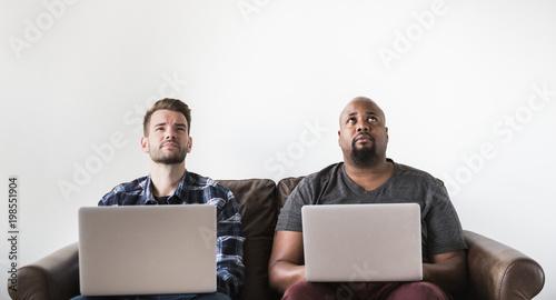 Papiers peints Two man working on laptop