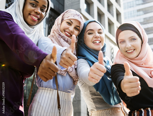 Group of islamic women gesturing thumps up Wall mural