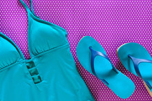 Womens Clothing, Shoes (blue Green Swimsuit, Flip Flops) On Violet Background In Polka Dots. Trendy Fashion Outfit. Shopping, Travel, Summer, Beach Concept, Abstract.  Flat Lay. Copy Space
