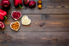 Proper Nutrition For Pathients With Heart Disease. Cholesterol Reduce Diet. Vegetables, Fruits, Nuts In Heart Shaped Bowl On Dark Wooden Background Top View Copy Space