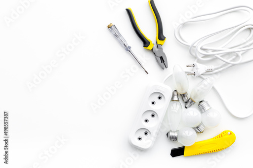 electrical installation, wiring works  tools and socket outlet on white  background top view copy