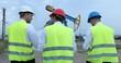 Team of Engineers Men Talking Planning Platform Gas and Visiting Oil Pump Field