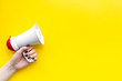 canvas print picture - Megaphone make an announcement on yellow background top view copy space