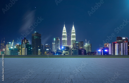 Recess Fitting Kuala Lumpur Empty square ground floor with city skyline background . Night scene .