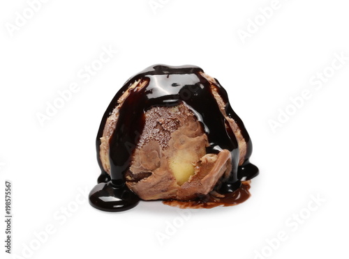 Fotografía  Chocolate ice cream ball with chocolate topping isolated on white background