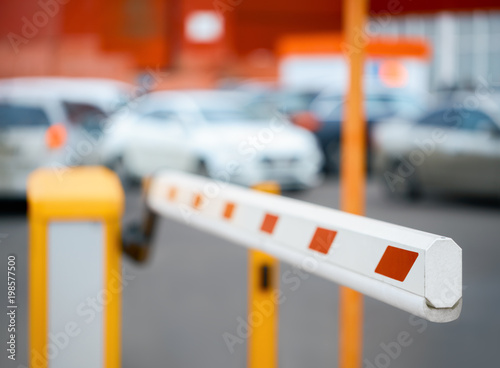 barrier close-up against the background of car parking Wallpaper Mural