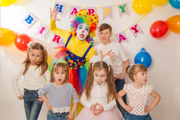 clown girl on the birthday of a child. Party for children. Play and entertain boys and girls