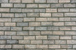 Wooden bricks shaped like concrete material wall, texture with scratches
