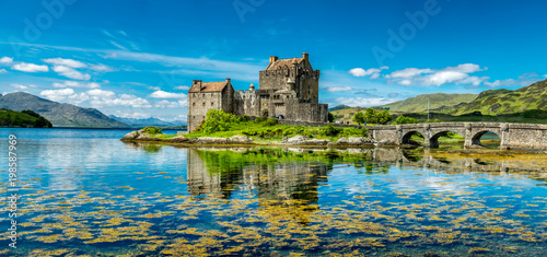 Photo Stands Historical buildings Eilean Donan Castle during a warm summer day - Dornie, Scotland