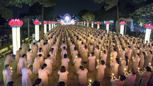 Ho Chi Minh City, Vietnam - January 3, 2018: Buddhists Pray Buddha Amitabha Chickened Oriented Festival Stage With Flickering Candles Illuminates Halo Radiating Toward The Night In Ho Chi Minh, Vienam