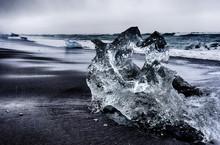 Large Ice Rocks Sitting In Bla...