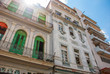 Traditional buildings in classic style with colorful facades on the background of blue sky with clouds. Havana. Cuba