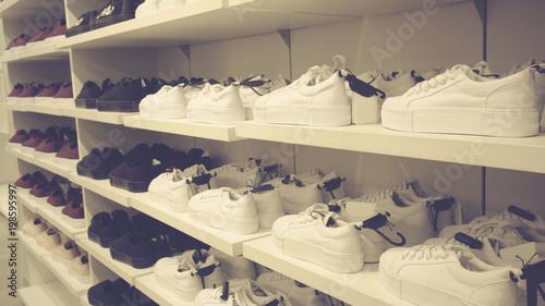 Fotografija  sneakers in the store on the shelves