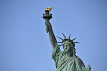 The Statue Of Liberty, Landscape Perspective, Crown And Torch With Blue Summer Sky