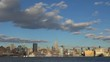Timelapse of New York City waterfront tall tower by day, Empire State building icon