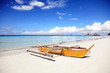 Traditional Filipino outrigger boat stranded on the beach, Boracay Island, Philippines