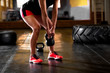 Female crossfit athlete exercise at crossfit gym