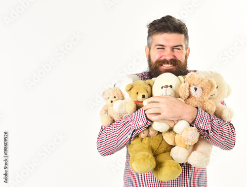 Photo  Generous man prepared many teddy bears as gifts.