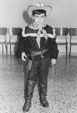 Young Boy Dressed As Cowboy In...