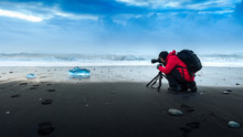Photographer Take A Photo At Ice In Iceland.