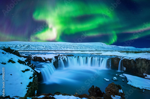 Poster Northern Europe Northern Light, Aurora borealis at Godafoss waterfall in winter Iceland.