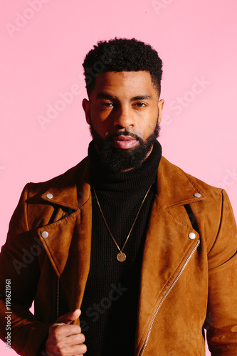 Fotografie, Obraz  Simple portrait of a cool African American man with beard, isolated on pink stud