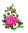 Pink peonies and anemone flowers in a corner floral arrangement