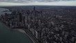 Chicago high altitude wide aerial view flying over Lake Michigan looking towards the downtown core city skyline