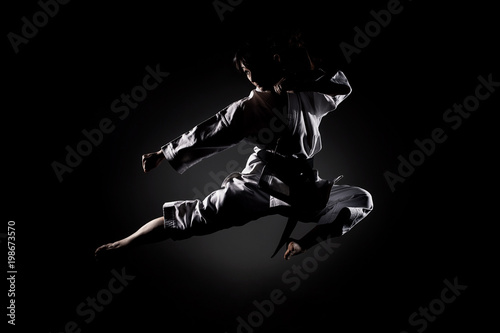 Photo Stands Martial arts girl exercising karate