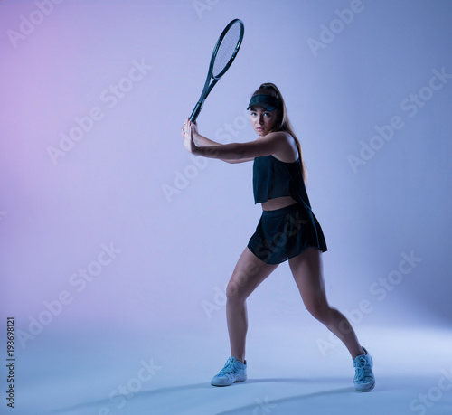 Young tennis player preparing  to  make forehand shot Canvas Print