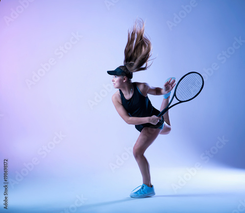 Young tennis player is making the hit